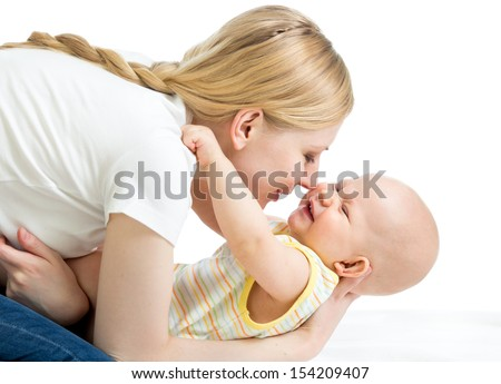 happy mother having fun with her baby boy infant - stock photo