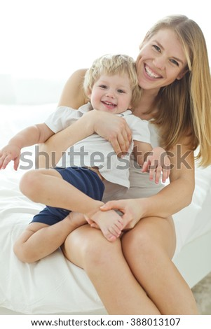 happy mother holding her child - stock photo