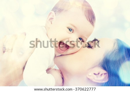 happy mother kissing baby - stock photo