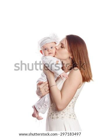 Happy mother kissing her daughter. Isolated on white background. The concept of happiness is having children. - stock photo