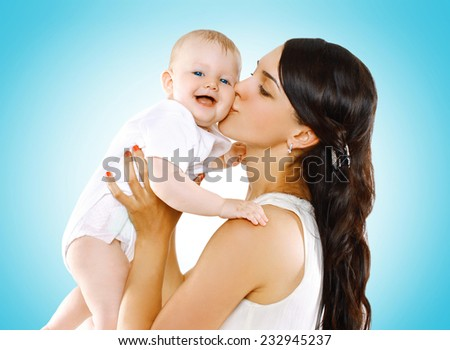 Happy mother kissing lovely baby - stock photo