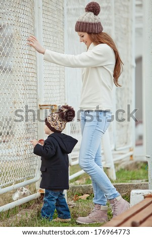 happy mother playing with her son in the park - stock photo