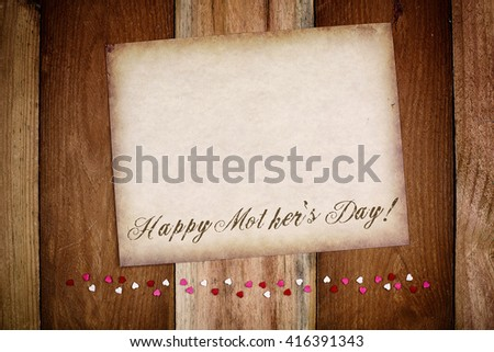 Happy Mother's Day background  Old paper on the wood with small hearts - stock photo