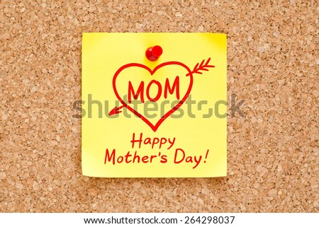 Happy Mother's Day concept on a sticky note pinned on cork bulletin board.  - stock photo