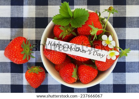Happy Mother's Day with bowl of strawberries  - stock photo
