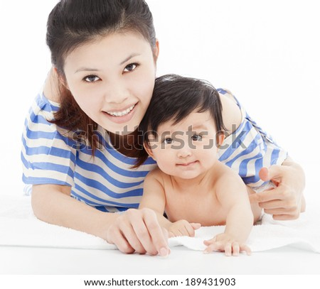 Happy  mother with adorable child baby boy - stock photo