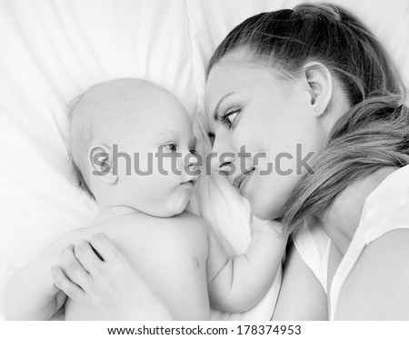 happy mother with baby - stock photo