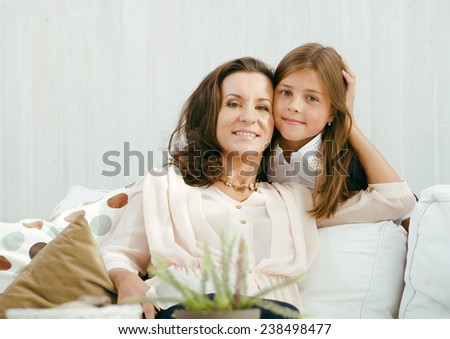 happy mother with daughter at home, real family smiling - stock photo