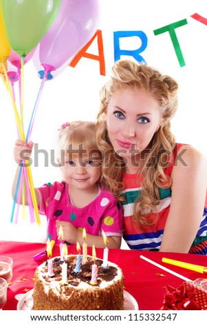 Happy mother with her baby girl celebrating birthday, on white - stock photo