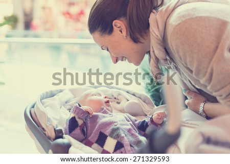 Happy mother with her baby in shopping - stock photo