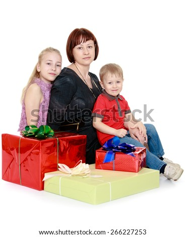 Happy mother with her children on the background Gift - isolated on white background - stock photo