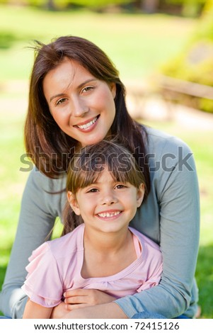 Happy mother with her daughter in the park - stock photo