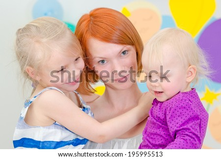 Happy mother with her two daughters. - stock photo