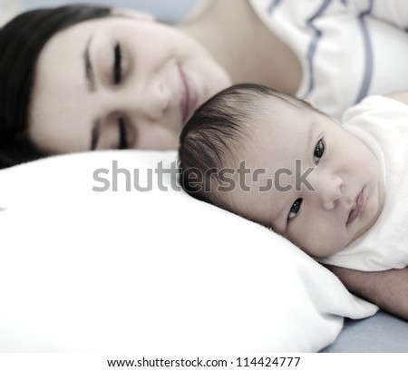 Happy mother with newborn baby - stock photo