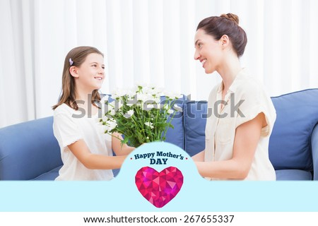 happy mothers day against daughter giving mother white bouquet - stock photo