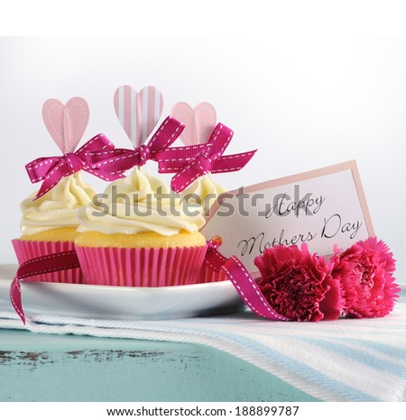 Happy Mothers Day aqua blue vintage retro shabby chic tray with pink cupcakes with pink hearts and ribbon decoration and gift tag - stock photo