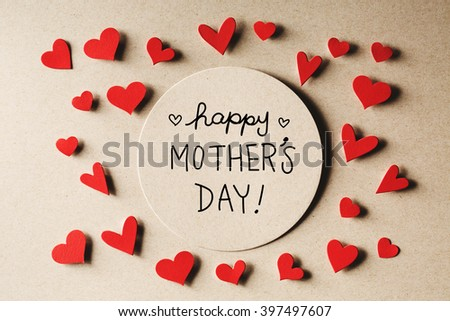 Happy Mothers Day message with handmade small paper hearts - stock photo