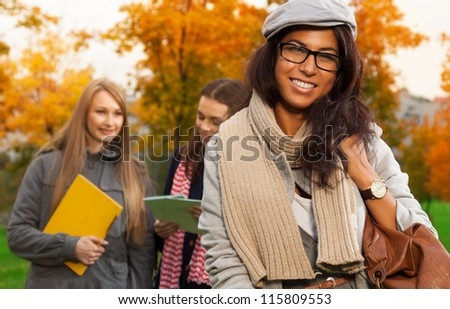 Happy mulatto student going home after classes - stock photo