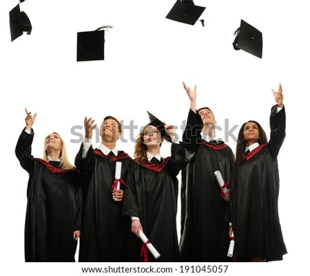 Happy multi ethnic group of graduated young students throwing hats isolated on white - stock photo