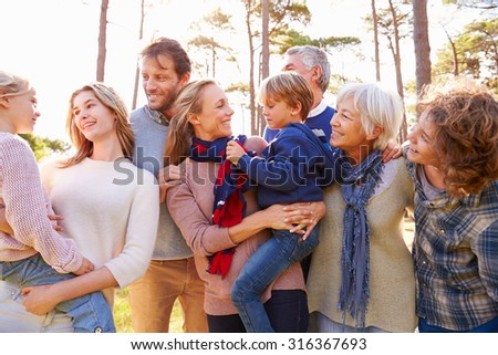 Happy multi-generation family in the countryside - stock photo