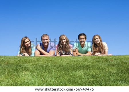 Happy, Multi-racial group of Young Adults outdoors - stock photo