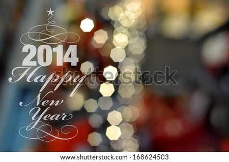 Happy New Year 2014. Blurred background with lights, selective focus. - stock photo