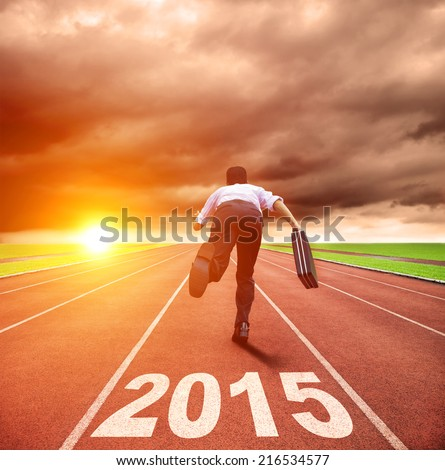 happy new year 2015. businessman running with sunrise background - stock photo