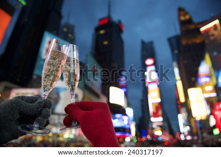 Happy New Year champagne toast couple in Times Square New York City - stock photo
