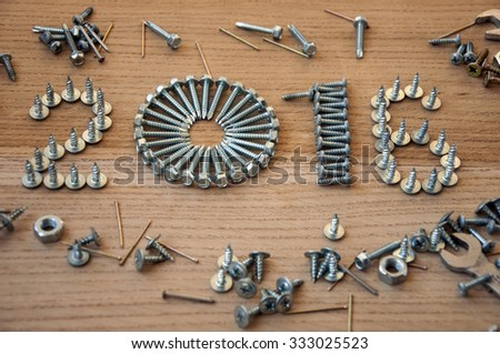 Happy new year 2016 composition with screws nails bolts and dowels - stock photo