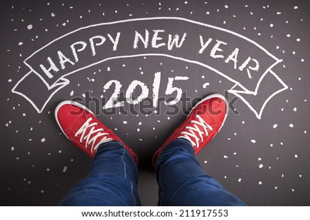 Happy new year 2015 concept with red shoes and white chalk - stock photo
