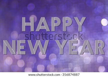 Happy new year congratulation on festive bokeh background - stock photo