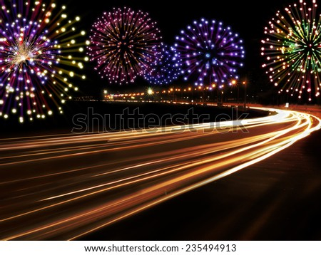 Happy New Year fireworks and city cars highway lights with copy space for your own text. - stock photo