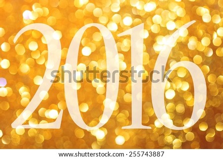Happy New Year 2016. Gold glittering christmas lights. Blurred abstract background - stock photo