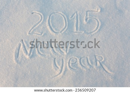 Happy 2015 New Year greetings written on snow - stock photo