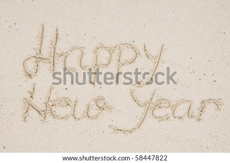 Happy New Year in the sand - stock photo