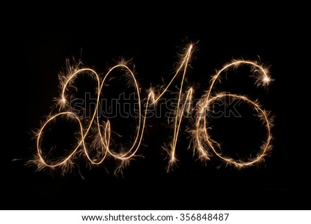 Happy New Year 2016 inscription sparklers. - stock photo