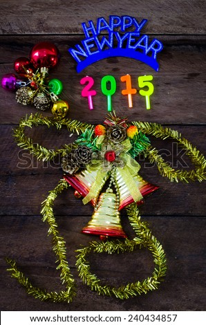 happy New Year message and gift box on wooden background. - stock photo