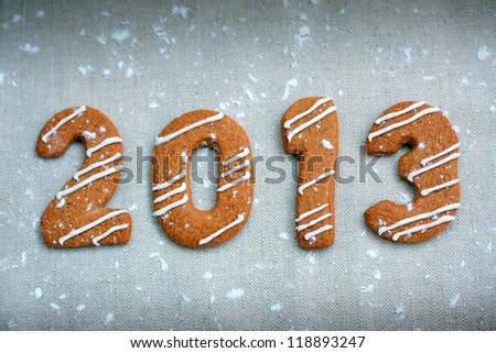 Happy new year 2013 message, christmas cookies in shape numeral - stock photo