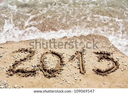 Happy New Year 2013 on ocean beach - stock photo