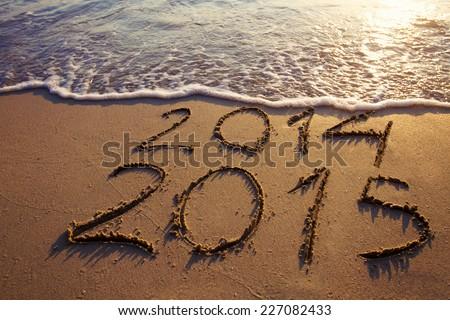 happy new year 2014 2015 on the beach - stock photo