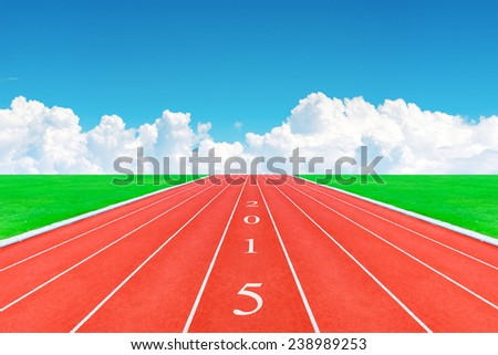 happy new year 2015 ,  race track in blue sky  with numbering year 2015  - stock photo