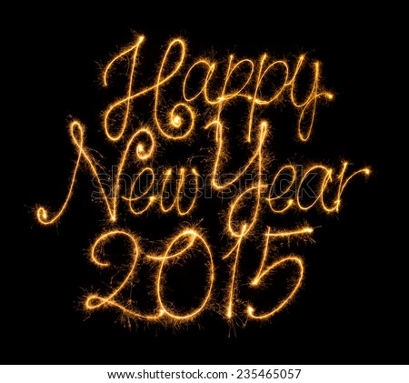 Happy New Year 2015 set in sparkly handwriting design on black background. - stock photo