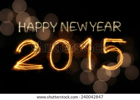 Happy New Year 2015 sparkle firework writing with unfocused dirty gold light blur bokeh background - stock photo