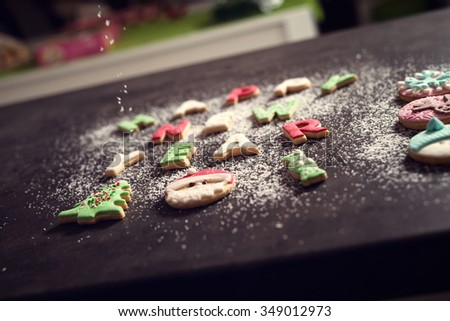 Happy new year. Spilled cookies. Christmas tree, Santa Claus, candy. Shallow depth of field. - stock photo