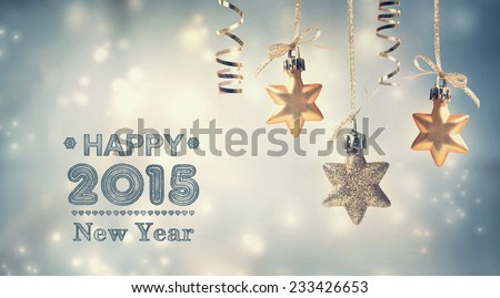 Happy New Year 2015 text with hanging star ornaments - stock photo