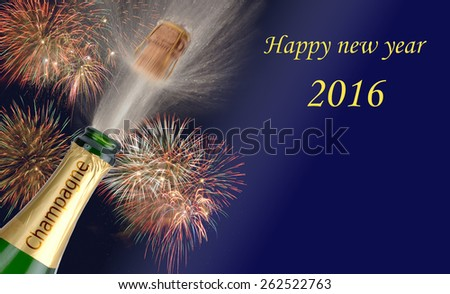 Happy new year 2016 with popping champagne and firework - stock photo