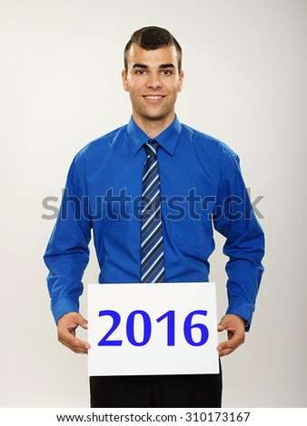 Happy new 2016 year, with young businessman in blue shirt holding paper - stock photo