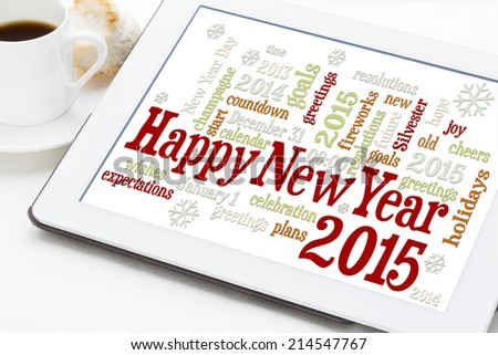 Happy New Year 2015 - word cloud on a digital tablet with a cup of coffee - stock photo