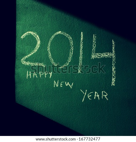 happy new year 2014 written with chalk on a green chalkboard - stock photo