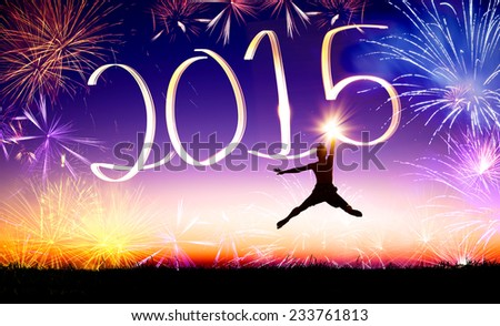 happy new year 2015 . young man jumping on the hill  - stock photo
